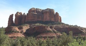Cathedral Rocks rises over an amber field in Sedona stock photos