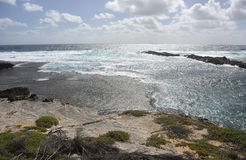 Cathedral Rocks Shoreline. With glistening Indian Ocean seascape and limestone rock at Rottnest Island in Western Australia Royalty Free Stock Photos