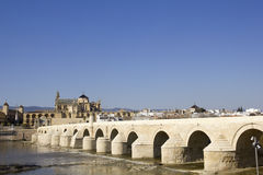 Cathedral and roman bridge. Cordoba Stock Photos