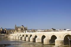 Cathedral and roman bridge. Cordoba Stock Photos