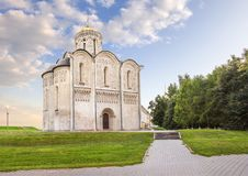 Cathedral of Saint Demetrius. Vladimir, Russia. Cathedral of Saint Demetrius and the park alleys on a summer day. Vladimir, Russia royalty free stock images