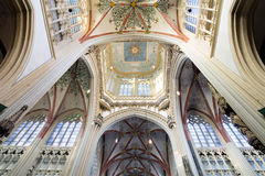 Cathedral Saint John Den Bosch. DEN BOSCH - FEBRUARY 25: Colorful ceiling in a symmetrical composition in the gothic medieval cathedral of Saint John, with the Royalty Free Stock Image