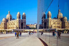 Cathedral of Saint Mary Major is reflected in the mirrored wall Royalty Free Stock Photos