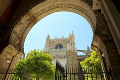 The Cathedral of Saint Mary of the See Seville Cathedral seen from an arabesque arch, Seville, Spain.  Royalty Free Stock Image