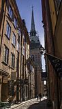 Cathedral of Saint Nicholas (Storkyrkan) in the end of narrow street, Stockholm Royalty Free Stock Image