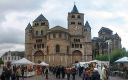 Cathedral of Saint Peter  in Trier. TRIER, GERMANY- SEPTEMBER 29: People in front of Cathedral of Saint Peter  in Trier, Germany, on September 29, 2012. Trier is Stock Photos