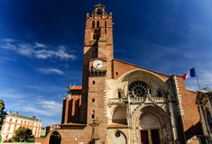 Cathedral of Saint Stephen, Toulouse, France. Cathedral of Saint Stephen with the French flag, Toulouse, France Royalty Free Stock Image