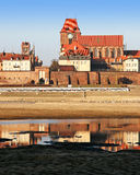 Cathedral of Saints Johns in Torun. View of Torun from left shore of Vistula river royalty free stock image