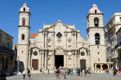 Cathedral San Cristobal on Plaza de la Catedral in Havana. Havana, Cuba - 7 january 2016 - People walking and taking pictures in front of Cathedral San Cristobal Stock Image