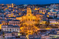 Cathedral of San Giorgio, Modica. Close view of the beautiful baroque Cathedral of San Giorgio in Modica, taken at blue hour with the first evening lights Royalty Free Stock Photo