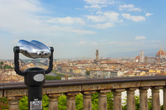 Cathedral of Santa Maria del Fiore and basilica of Santa Maria Novella in front of touristic binoculars, Florence. Italy. Stock Photo