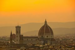 Cathedral of Santa Maria del Fiore Duomo. Amazing evening golden hour light. View from Piazzale Michelangelo. Beautiful gold sunset in Florence, Italy stock photos