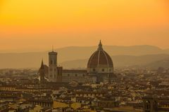 Cathedral of Santa Maria del Fiore Duomo. Amazing evening golden hour light. View from Piazzale Michelangelo. Beautiful gold sunset in Florence, Italy royalty free stock images