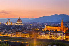Cathedral of Santa Maria del Fiore and Palazzo Vecchio in Florence at sunset Royalty Free Stock Photography