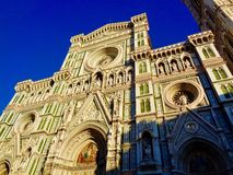 Low-angle view of the facade of Florence Cathedral stock photography