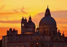 Colorful sunset over the church Santa Maria della Salute in Venice. Cathedral Santa Maria della Salute in Venice during sunset stock photos
