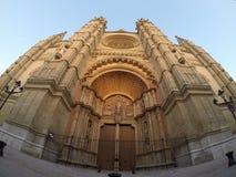 The Cathedral of Santa Maria of Palma de Mallorca. La Seu, Spain. Touristic destinations in Palma. Wide lens shot of the main facade with beautiful portal Stock Photos