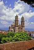 Cathedral of Santa Prisca. Spectacular clouds frame Santa Prisca Cathedral built in baroque style in Taxco, colonial town of Mexico stock images