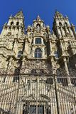 Cathedral: Facade perspetive from below. Old iron gate, facade closeup with clean stone. Sunny day, Santiago de Compostela. Spain. royalty free stock images