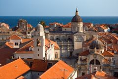 Cathedral seen from walls. Dubrovnik's cathedral, sguare and church seen from the city walls Royalty Free Stock Images