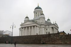Cathedral on Senate Square in Helsinki, Finland. Side view. People walk around stock photography