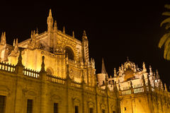 Cathedral of Seville illuminated at night. Spain Stock Photography