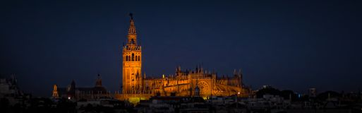 Cathedral of Seville. The Cathedral of Seville in the spotlights in the evening or night Stock Images