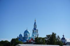 Cathedral. Sky sun summer greatness purity white trees cupola blu royalty free stock photography