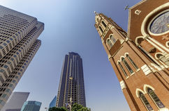 Cathedral and Skyscrapers. The Cathedral Shrine of the Virgin of Guadalupe (Dallas), Surrounded by Skyscrapers Royalty Free Stock Photo
