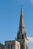 Cathedral Spire. A cathedral spire set against a blue sky, showing a ladder rigged to the top Stock Photo