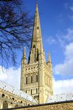 Cathedral spire. Shot looking up at the spire of Norwich Cathedral against a clear blue sky beyond stock image