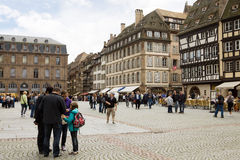 The cathedral square in Strasbourg with tourists Royalty Free Stock Image