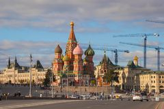 The Cathedral of St. Basil the Blessed in Red Square on the background of GUM Stock Photo