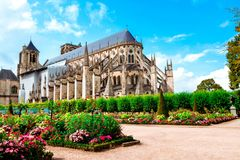 The Cathedral of St Etienne of Bourges, beautiful garden, France. Cathedral in Bourges, beautiful garden France. Sunny day. UNESCO World Heritage List stock image