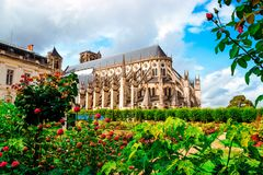 The Cathedral of St Etienne of Bourges, beautiful garden, France. Cathedral in Bourges, beautiful garden France. Sunny day. UNESCO World Heritage List stock photography