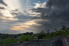Photo series - Cathedral of St. George in the city of Kamyanets-Podolsky, Ukraine, under the dramatic sky. -   3 stock images
