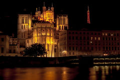 Cathedral St Jean Baptiste and Basilica Notre Dame in Lyon at night, France Stock Photography