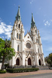 Cathedral of St John the Baptist in Savannah, GA. Cathedral of St. John the Baptist, a historic church in Savannah, GA USA.  Set against a vibrant blue sky with Royalty Free Stock Image