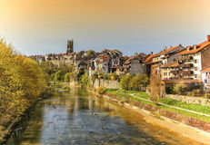 Cathedral of St. Nicholas and Sarine river in Fribourg, Switzerland Royalty Free Stock Images