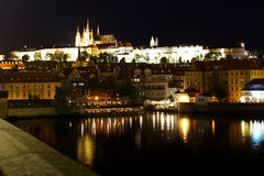 Cathedral of St. Vitus and Prague Castle at night. Stock Photos