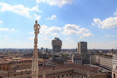 Cathedral statue and view of Milan cityscape with Torre Valesca Stock Photography