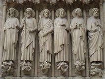Cathedral statutes. Close view of statutes on western façade of Notre Dame Cathedral, Paris Stock Images