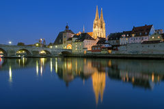 Cathedral and Stone Bridge in Regensburg at evenin Royalty Free Stock Photos