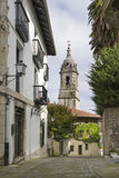 Cathedral and street in Lekeitio. Royalty Free Stock Image
