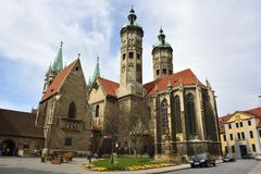 Cathedral of Sts Peter and Paul Dom in Naumburg. Naumburg, Germany  - April 13, 2016. Cathedral of Sts Peter and Paul Dom in Naumburg, with surrounding buildings Royalty Free Stock Photo
