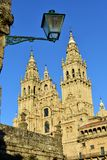 Cathedral with sunset light and green street light. Obradoiro Square, baroque facade and towers. Santiago de Compostela, Spain. Santiago de Compostela, Spain royalty free stock image