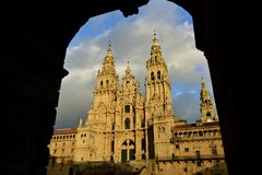 Cathedral with sunset light, view from Town Hall arch. Obradoiro Square, rainy day, grey sky. Baroque facade and towers, Santiago. Santiago de Compostela, Plaza royalty free stock photos