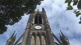 Cathedral tower 7s. A view on an old Gothic style Cathedral and trees, UK, Newcastle upon Tyne stock video
