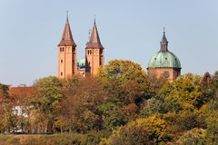 Plock. Cathedral towers amidst autumnal trees, Tumskie Hill in Plock, Poland stock photography
