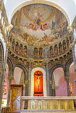 The Cathedral of Tunis. TUNIS, TUNISIA - AUGUST 30, 2015: The apse of the catholic Cathedral of St Vincent de Paul with the beautiful icons inside of cupola, on Stock Photo
